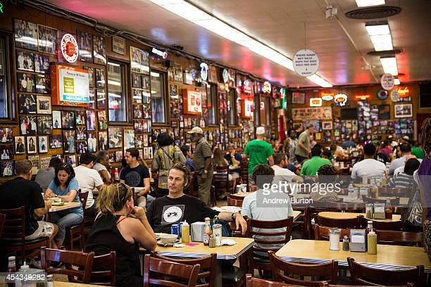 People dine at Katz's Deli on August 29 2014 in New York City The iconic New York deli recently sold the air rights to above their building...