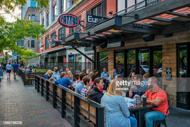 people dine at restaurant patio in downtown boise idaho usa - idaho stock pictures, royalty-free photos & images
