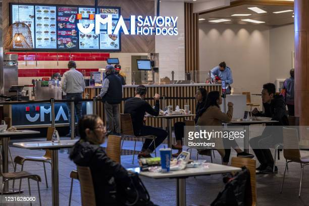 People dine at the food court inside the Westfield San Francisco Centre shopping mall in San Francisco, California, U.S., on Tuesday, March 9, 2021....