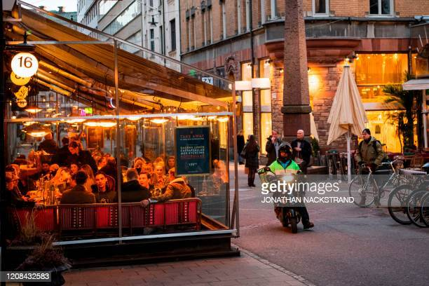 People dine in a restaurant on March 27, 2020 in Stockholm during the the new coronavirus COVID-19 pamdemic. - Sweden, which has stayed open for...