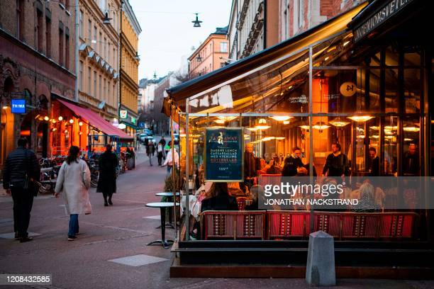 People dine in a restaurant on March 27 2020 in Stockholm during the the new coronavirus COVID19 pamdemic Sweden which has stayed open for business...