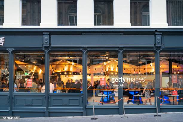people dine in restaurant in downtown glasgow scotland uk - glasgow scotland stock photos and pictures