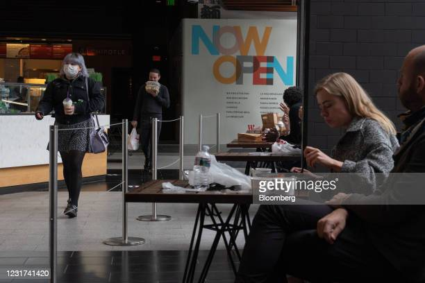 People dine inside the food court at the Westfield Century City shopping mall in Los Angeles, California, U.S. On Monday, March 15, 2021....