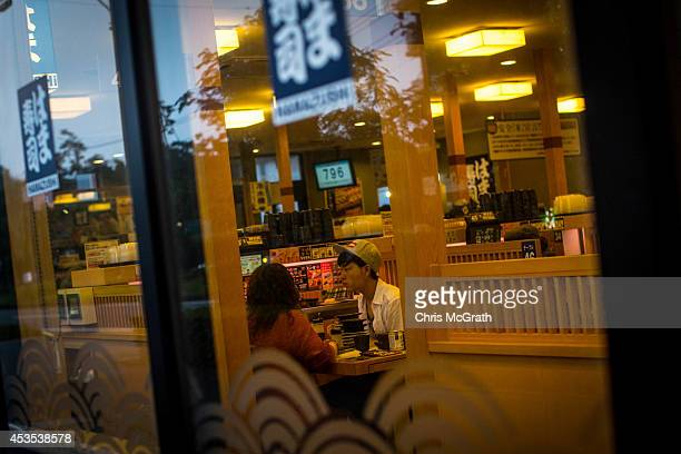 People dine out at a popular sushi restaurant on August 10 2014 in Omaezaki Japan The town of Omaezaki is living in the shadow of what is said to be...