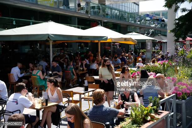 People dine outdoors at South Bank on July 17, 2021 in London, England. The UK government is set to relax planning rules for hospitality industry.