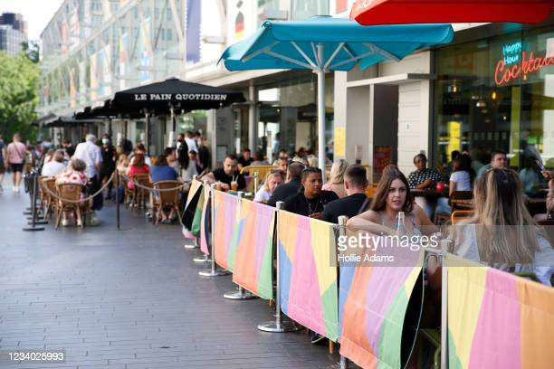 People dine outdoors in South Bank on July 17, 2021 in London, England. The UK government is set to relax planning rules for hospitality industry.