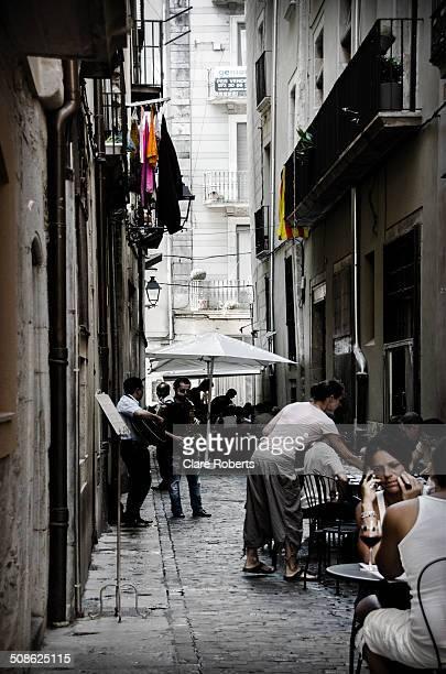 People dining in the street. Girona, Costa Brava, Spain