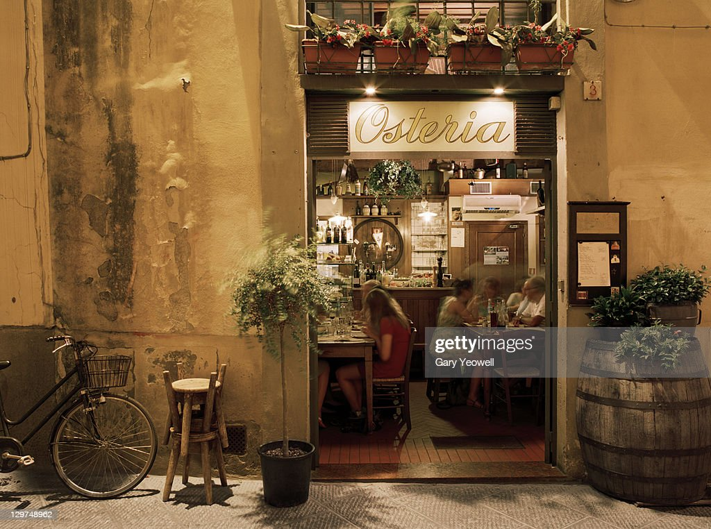 People dining inside an Osteria : Stock-Foto