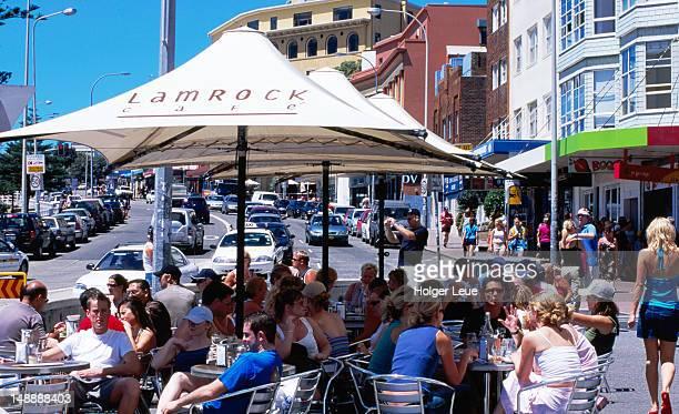 People dining outdoors at Lamrock Cafe, Bondi.