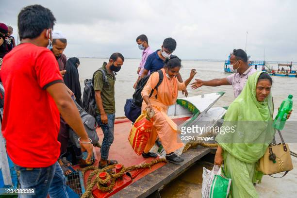 People disembark from a launch in Munsiganj to return to their work areas in Dhaka after government relaxed the lockdown restrictions. Thousands of...