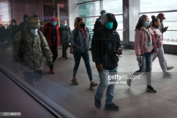 People disembark the Staten Island Ferry, which commutes between Staten Island and Manhattan on April 27, 2020 in New York City. Hospitals in New...