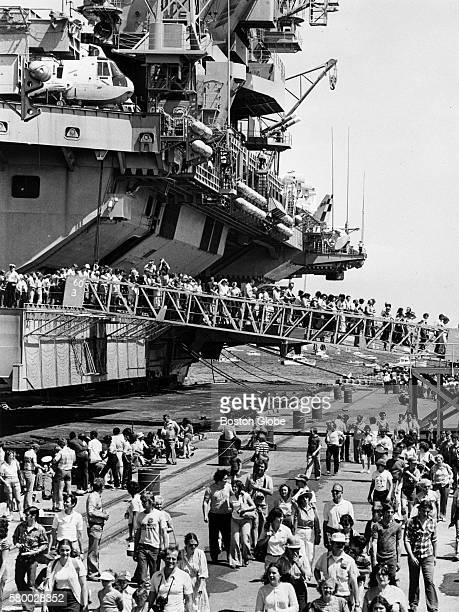 People disembark the USS John F Kennedy an aircraft carrier after taking a tour during the Tall Ships event in Boston on June 1 1980