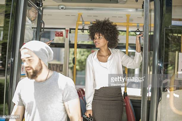 people disembarking from city bus - disembarking stock pictures, royalty-free photos & images