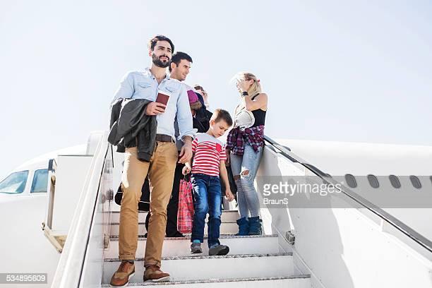 People disembarking the plane.