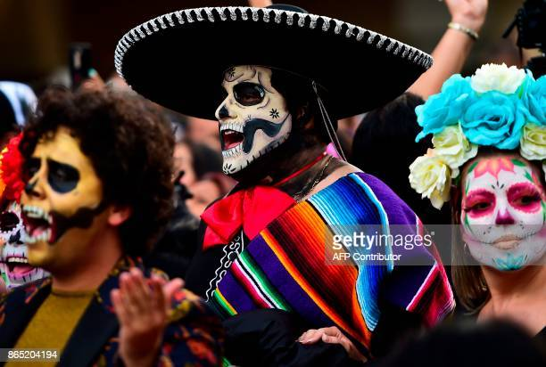 People disguised as Catrina take part in the Catrinas Parade along Reforma Avenue in Mexico City on October 22 2017 Mexicans get ready to celebrate...