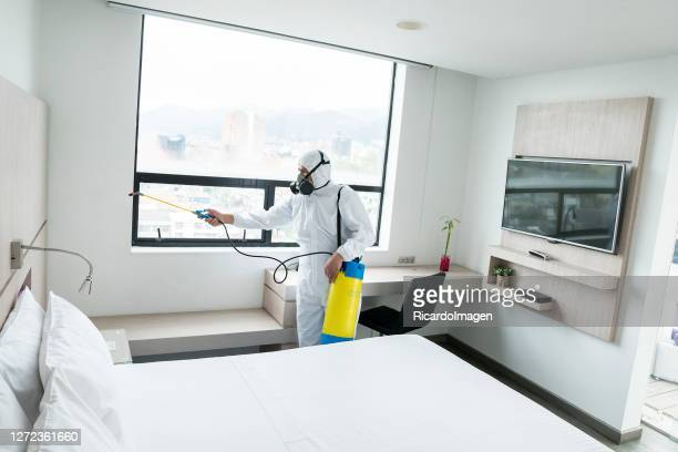 people disinfecting hotel areas to prevent covid-19 - hotel stock pictures, royalty-free photos & images