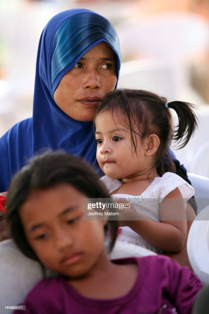 People, displaced by continuing armed conflict between the supporters of Philippine Muslim clan Sulu Sultan Jamalul Kiram III and Royal Malaysian Police in Sabah, Malaysia, arrive at Bonggao on March 29, 2013 in Bonggao, Tawi-Tawi, Philippines. Following the insurgency in Sabah and the Malaysian government's subsequent crackdown on undocumented Filipinos, over 4000 people, mostly Filipino Muslims, have begun evacuating to the southern provinces of Basilan, Sulu, and Tawi-Tawi in the Philippines, with numbers expected to reach more than 100,000.