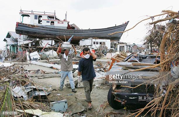 People displaced by the tsunamis, walk amid their ruined neighbourhood on January 4, 2005 in Banda Aceh, Indonesia. Indonesia, the country hardest...