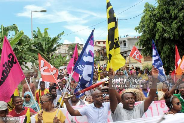 People display banners during a demonstration in Mamoudzou in the French overseas territory of Mayotte on February 20 2018 The demonstration was held...