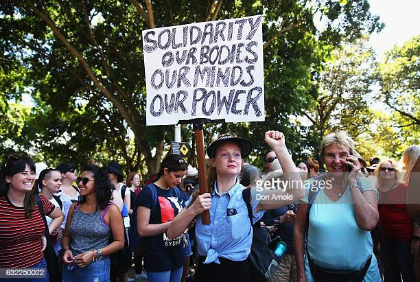 People display banners in Hyde Park on January 21, 2017 in Sydney, Australia. The marches in Australia were organised to show solidarity with those...