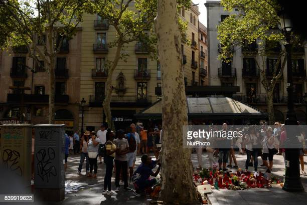 People display flowers messages and candles to pay tribute to the victims of the Barcelona and Cambrils attacks in Cambrils on August 26 2017 The...