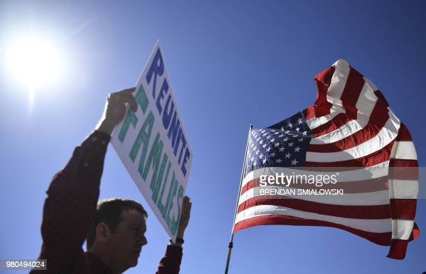 People display signs at the Tornillo Port of Entry near El Paso, Texas, June 21, 2018 during a protest rally including several American mayors...
