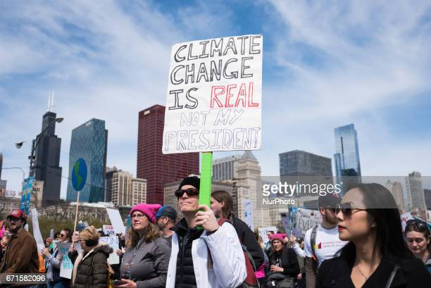 People display signs during the March for Science in Chicago on April 22 2017 Held on Earth Day the March for Science was held in support and in...