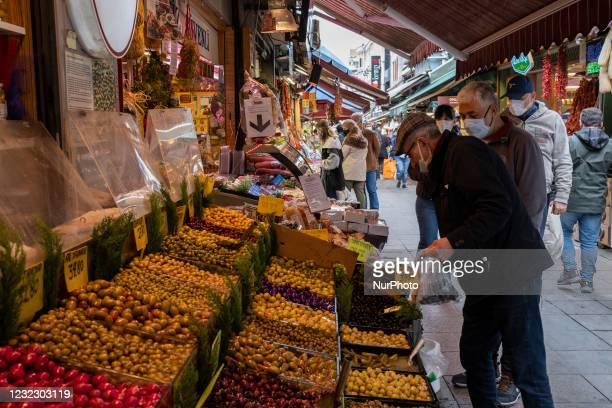 People do their shopping from the local market in the Kadikoy district of Istanbul, Turkey on the first day of fasting for the Muslim holy month of...