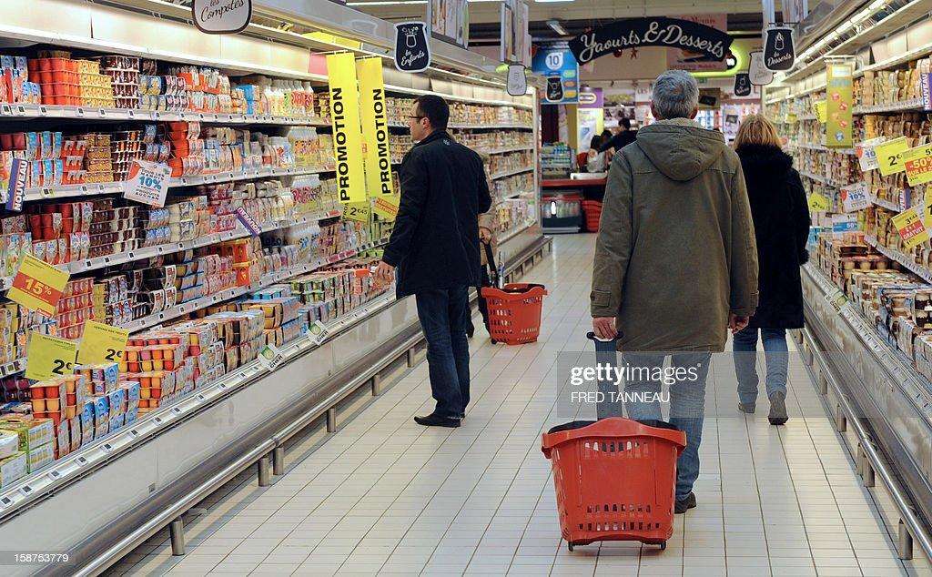 People do their shopping in a supermarket Auchan on December 27, 2012 in Saint-Sebastien-sur-Loire, western France.