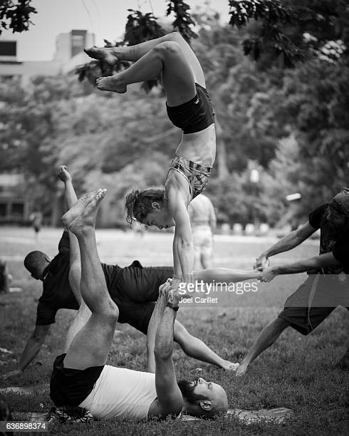 People doing acroyoga at Meridian Hill Park in Washington DC