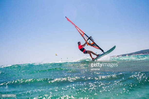 people doing kitesurfing and windsurfing - windsurfing stock pictures, royalty-free photos & images