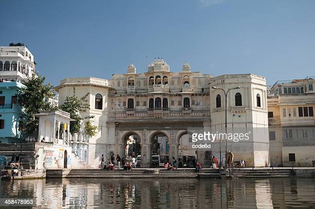 People doing laundry and bathing in Lake Pichola, Udaipur, India