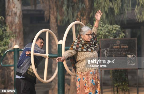 People doing their routine work in cold morning and smoggy weather in park at Bhajan Pura on December 4 2017 in New Delhi India Air quality remained...