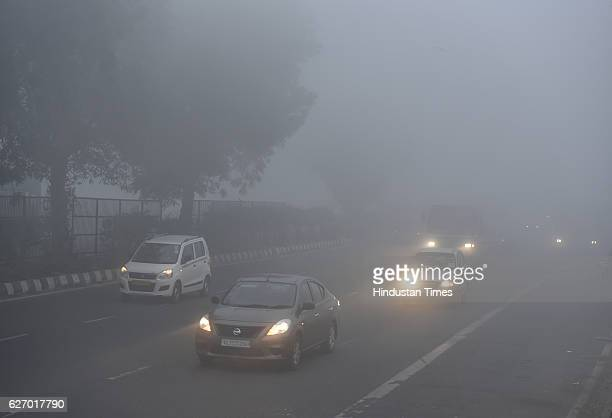 People doing their routine work on the foggy morning at Mayur Vihar Sector10 on December 1 2016 in New Delhi India Traffic was moving slowly...