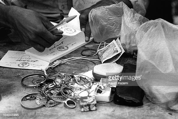 People donate money and jewels to support Iran financially in the war with Iraq at Friday Prayers at the university in Tehran 1982