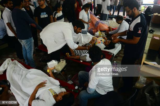 People donate their blood at Sasoon Hospital ahead of World Blood Donor Day on June 13 2018 in Pune India Every year on June 14 countries around the...