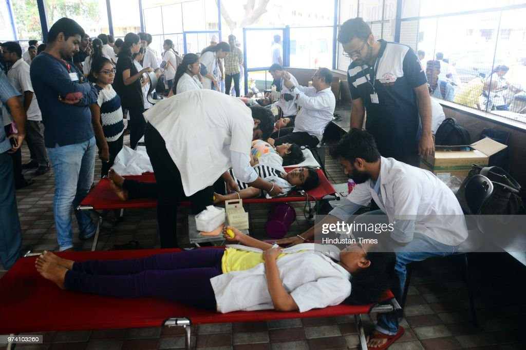 People donate their blood at Sasoon Hospital ahead of World Blood Donor Day, on June 13, 2018 in Pune, India. Every year on June 14, countries around the world celebrate World Blood Donor Day (WBDD). The event, established in 2004, serves to raise awareness of the need for safe blood and blood products, and to thank blood donors for their voluntary, life-saving gifts of blood.