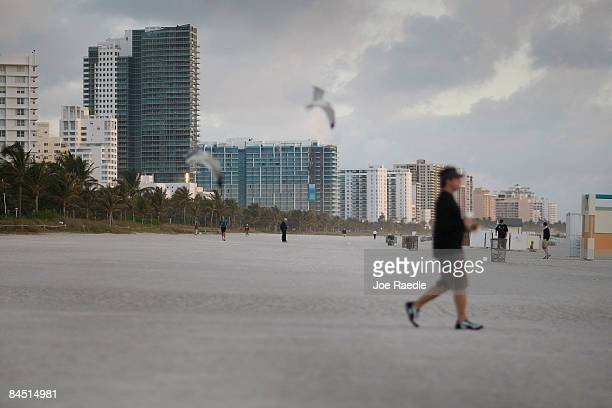 People dot the beach near the famed Ocean Drive strip on January 28 2009 in Miami Beach Florida As the economic downturn continues the number of...