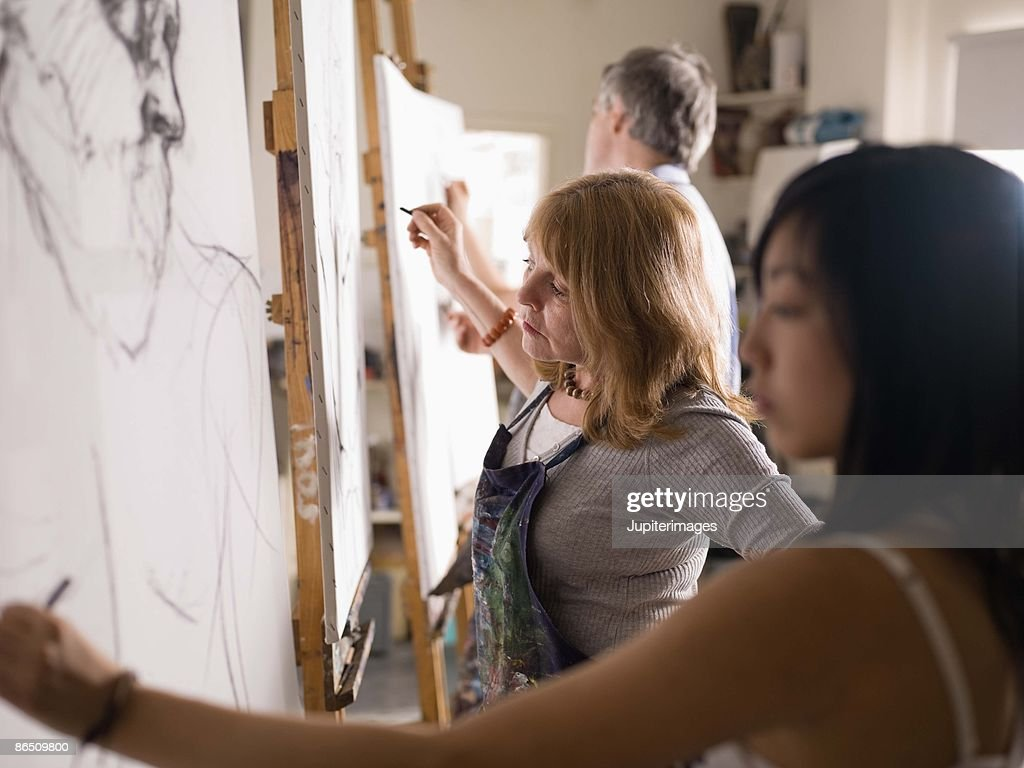 People drawing in art class : Stock Photo