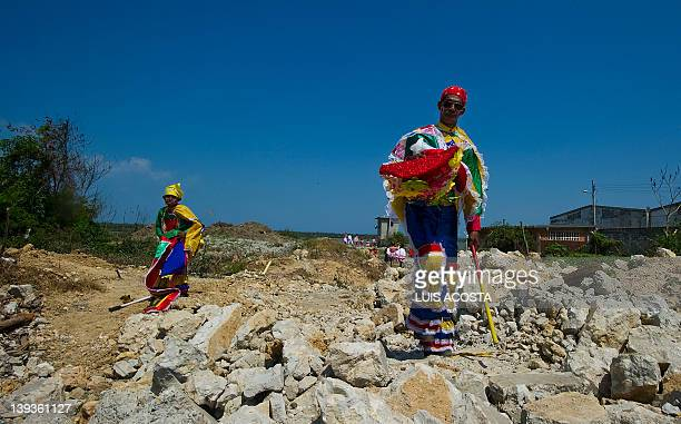 People dresed as 'Congos ' arrive to a carnival parade in Barranquilla Colombia on February 19 2012 Barranquilla's Carnival a tradition cretaed by...