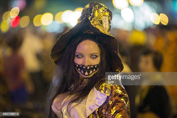 People dress in costume for the Halloween Carnaval on October 31 2015 in West Hollywood California Carnaval officials paid homage to the 40th...
