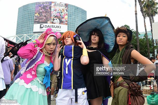 People dress in costume to attend the 24th annual Anime Expo in Los Angeles California on July 2 the largest Anime convention in North America which...