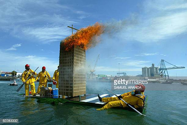 People dress like firefighters extinguishing the fire in the Windsor building of Madrid sail in their home made boat during the 'Achipencos'...