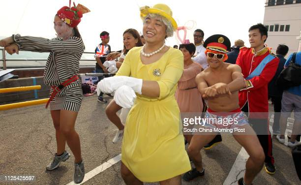 People dress up in various costumes and show off their Gangnam Style dance move at Sedan Chair Race Bazaar 2012 at The Peak organised by Sedan Chair...