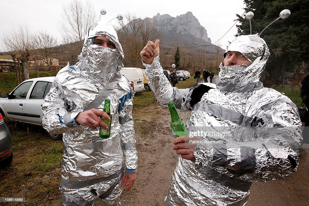 People dressed as aliens pose for the camera after the time passed 11.11 am, the time the Mayan Apocalypse was supposed to occur in Bugarach village on December 21, 2012 in Bugarach, France. The prophecy of an ancient Mayan calendar claimed that today would see the end of the world, and that Burgarach is the only place on Earth which will be saved from the apocalypse.