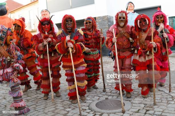 People dressed as Caretos take part in a winter masquerade gathering in Salsas Portugal on Saturday January 6 2018 With colorful costumes and ancient...