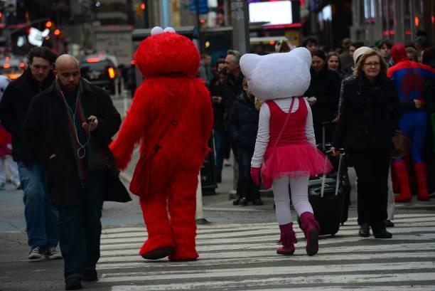 people dressed as cartoon characters elmo from sesame street l