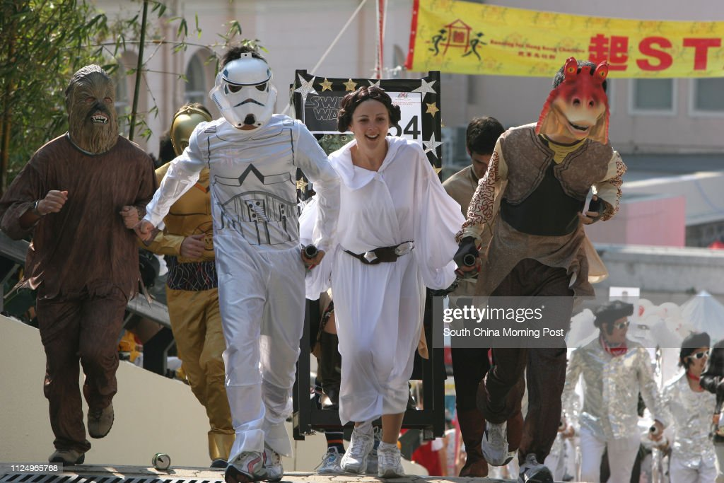 People dressed as characters in Star Wars' movies running on the race. Over 600 peoples running for Matilda Sedan Chair race to raise funds for Matilda International Hospital.  The annual Sedan Chair Race and Matilda Bazaar take place on The Peak.  12 Nov : News Photo