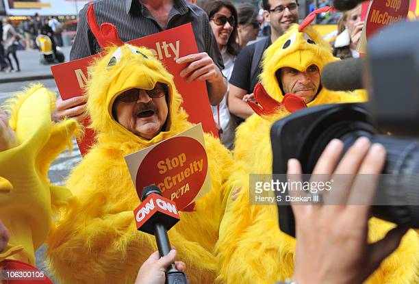 """People dressed as chickens give the lunch crowd at McDonald's some food for thought at the PETA """"Not a Nugget"""" protest outside of the Times Square..."""