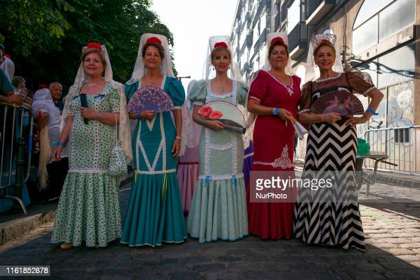 people dressed as 'chulapos' attend the Procession Virgin of Paloma festivities in Madrid Spain 15 August 2019 As each year thousands of people...
